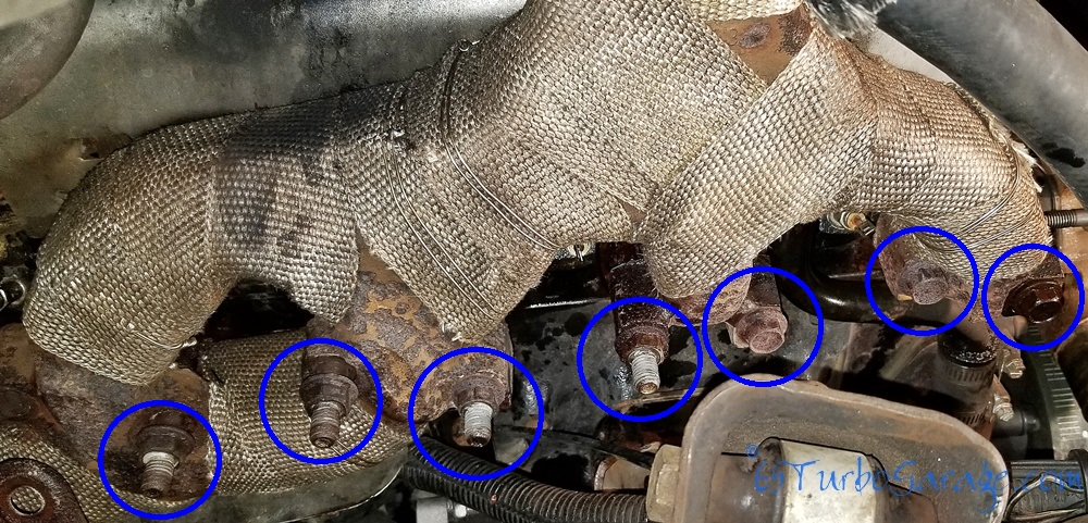 Remove the exhaust manifold bolts