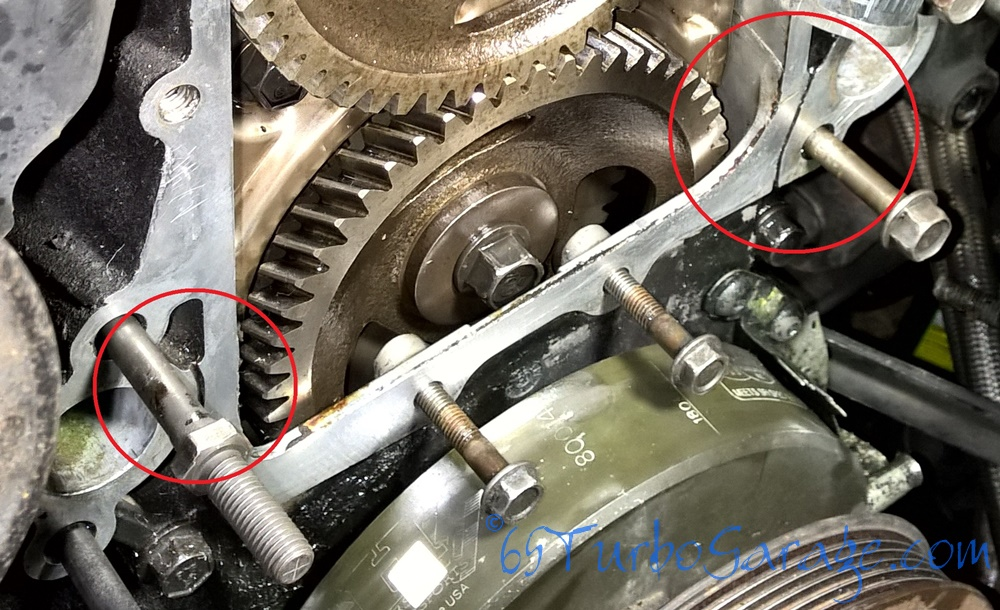 Timing cover drain holes